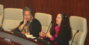 Commission member Vivien Feyer, right, discusses the need for the city to observe the 61st anniversary of the Declaration of Human Rights.