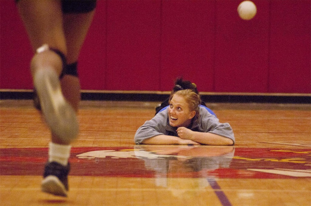 Volleyball coach lying on the floor.