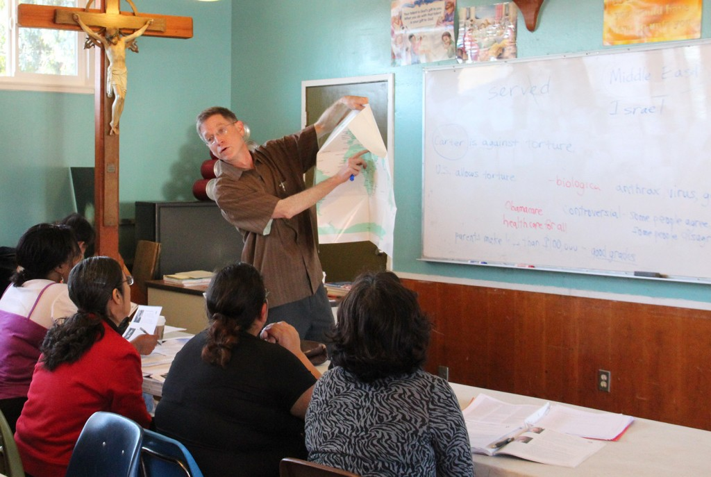 Kenneth Ryan shows his students a map of the Middle East.