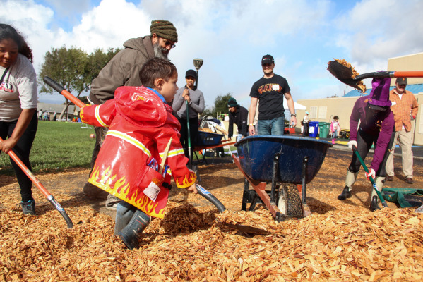 All shapes and sizes, volunteers took on a mountain of woodchips that would blanket the playground floor.