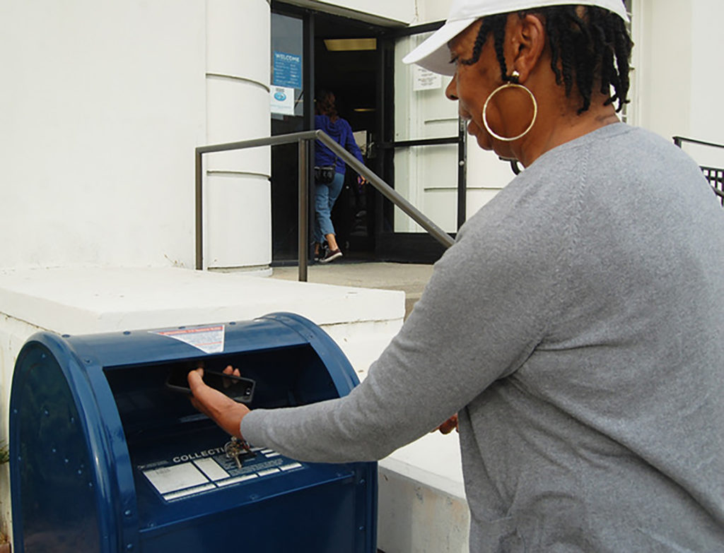 Richmond residents like Sharon Logan prefer the Main Post Office because of its convenient location.